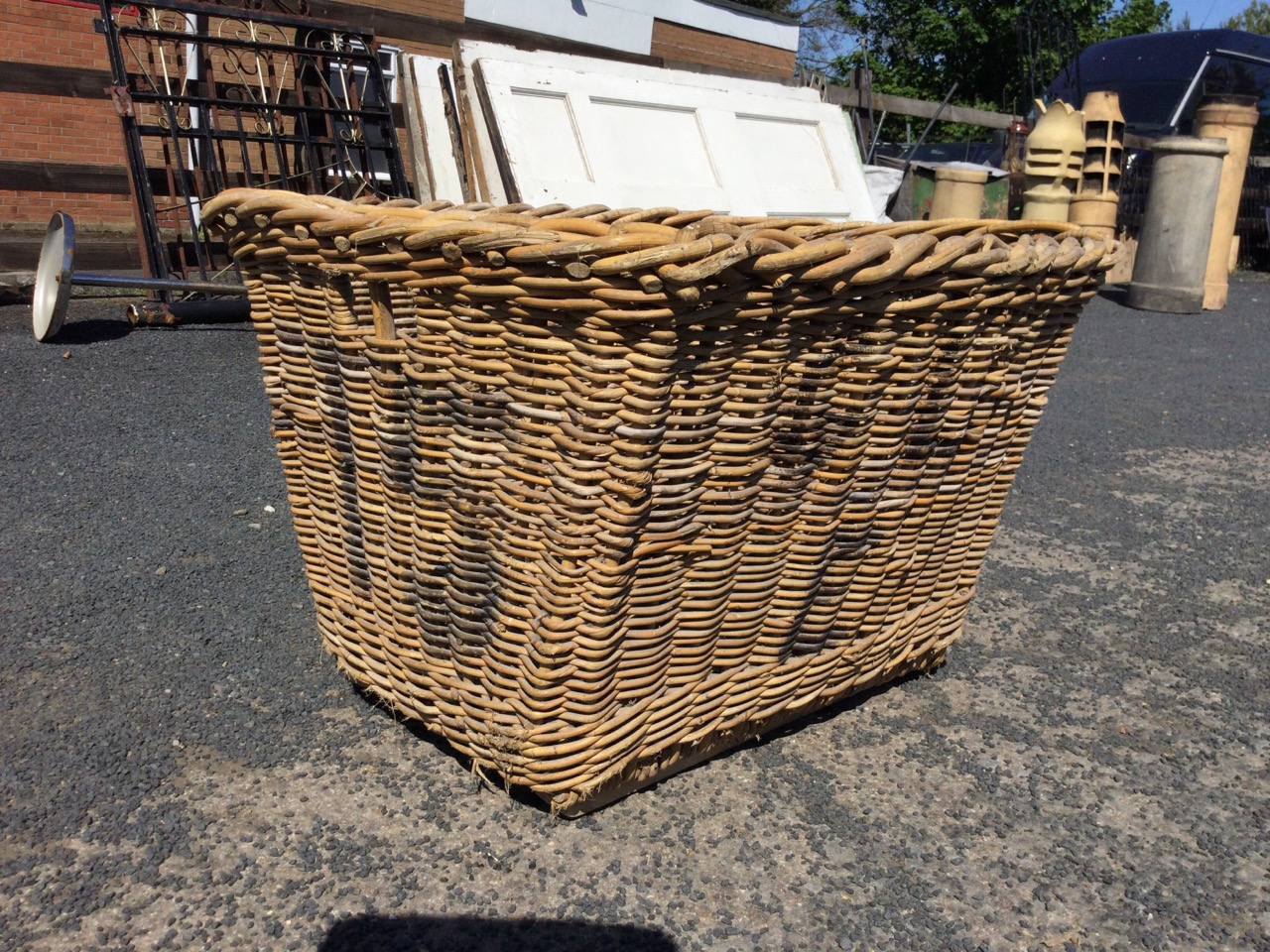 A cane log basket with angled sides, the ends with hand-holes, raised on rectangular batons. (31in x - Image 3 of 3