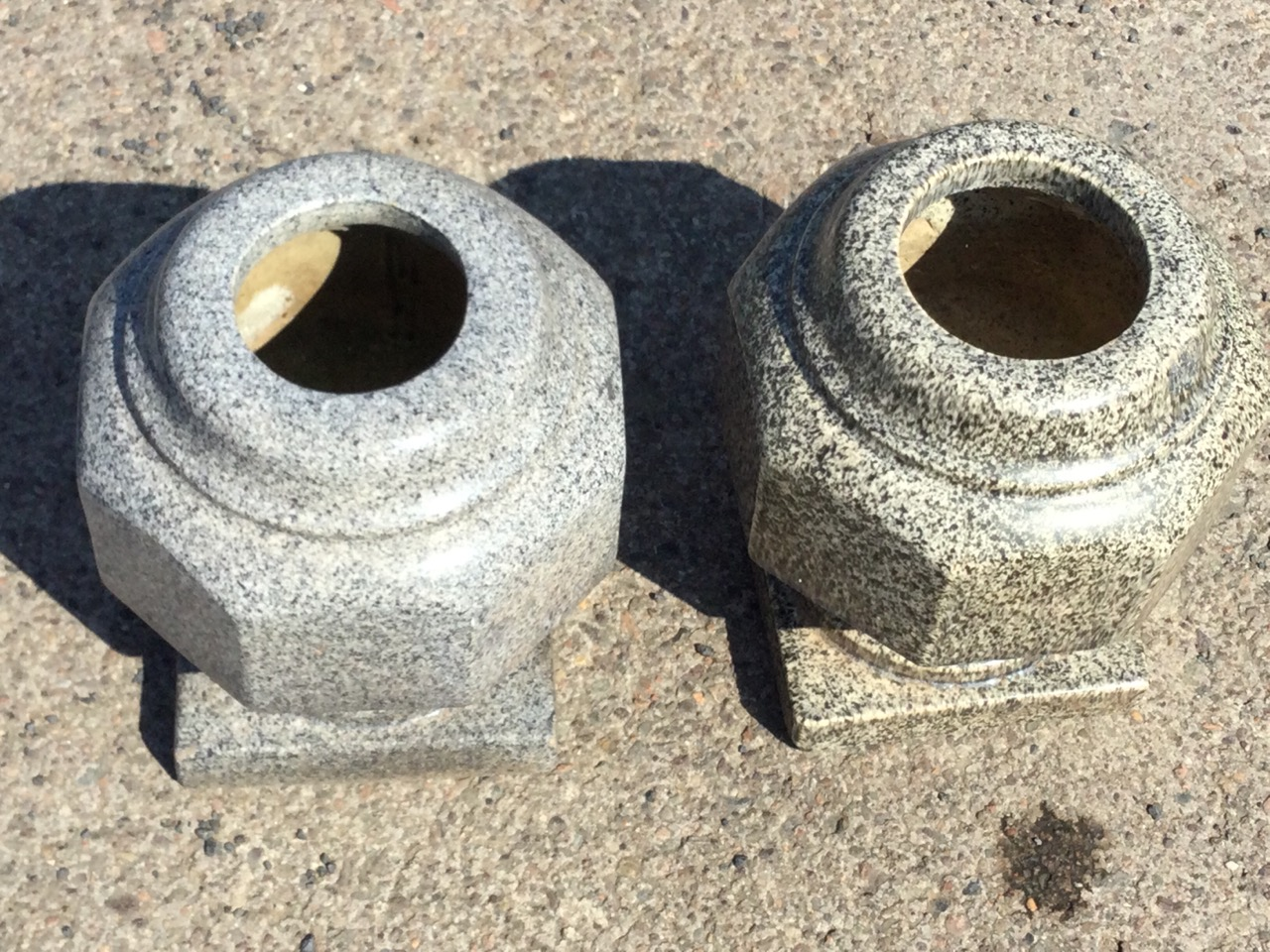 A matched pair of stoneware granite glazed octagonal urns with moulded rims, raised on square plinth - Image 3 of 3