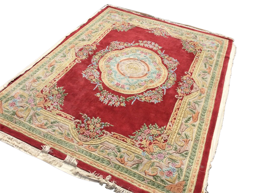A Chinese thick-pile floral carpet woven with central scalloped medallion framed by ribbon