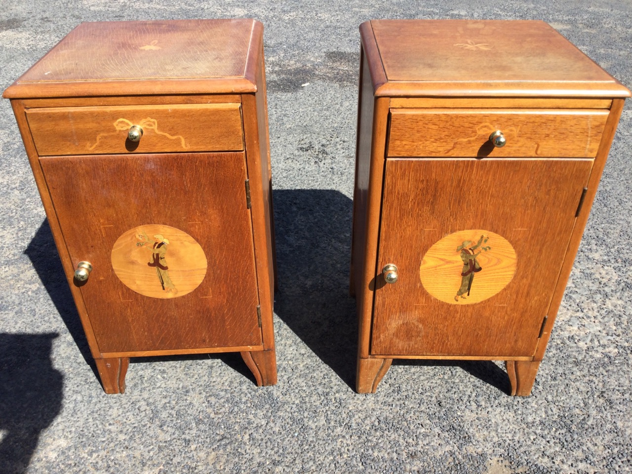 A pair of 1960s Ridgeway Cottage Industry oak bedside cabinets with marquetry by Colin Sawford, with