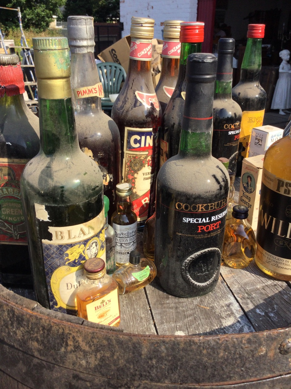 The residual contents of a booze cupboard including two bottles of Cockburns port, Martini, a bottle - Image 3 of 3
