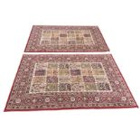 A pair of Egyptian made Valby Ruta rugs woven with rectangular fields of twenty four floral