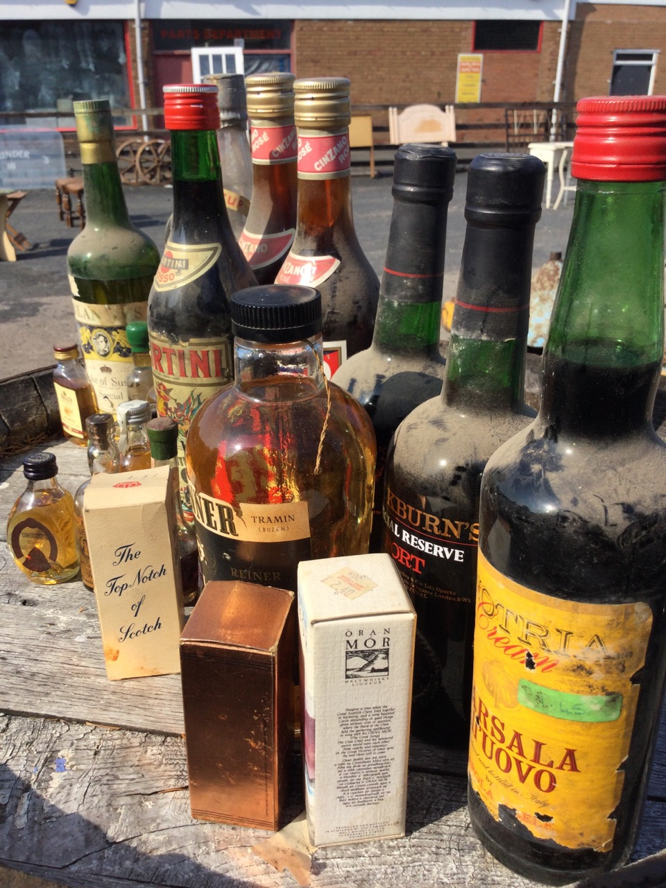 The residual contents of a booze cupboard including two bottles of Cockburns port, Martini, a bottle - Image 2 of 3