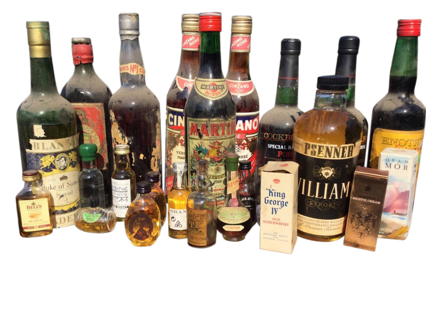 The residual contents of a booze cupboard including two bottles of Cockburns port, Martini, a bottle
