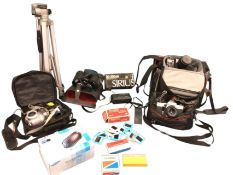A quantity of photographic gear including a cased Fujifilm S304 camera, a boxed zoom lens, a