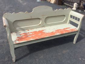 A painted bench seat with shaped back above twin rounded panels, the cushion moulded arms on