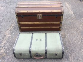 A canvas covered wood motoring trunk, the rounded case with leather handle and painted metal mounts;