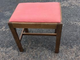 A Georgian style rectangular mahogany dressing table stool, having drop-in upholstered seat on