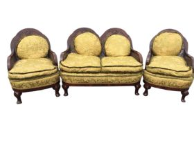 A 1940s mahogany bergére suite with two-seater sofa and two armchairs, the scalloped arched backs