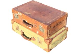 An Edwardian lined hand-stitched leather suitcase with chrome mounts; and a 1943 army canvas