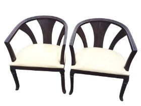 A pair of captain style armchairs, the rounded moulded rails on fluted fan shaped splats, the