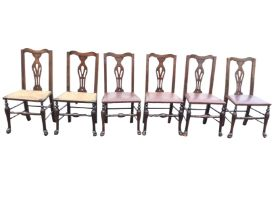 A set of six oak Queen Anne style dining chairs with shaped backs above pierced splats, having