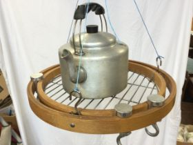 A contemporary kitchen utensil hanger with circular grill tray with revolving hooks; and an