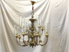 A large Dutch style silvered & gilt brass chandelier, with two tiers of scrolled branches supporting