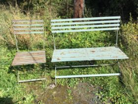 A folding painted metal garden bench & chair, the slatted backs and seats on iron cross-frames. (2)