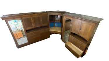 A Gillows of Lancaster fitted oak bedroom suite with moulded cornices, linen presses, wardrobes,