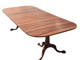 An 8ft reproduction Georgian style walnut dining table by Brights of Nettlebed, the rectangular