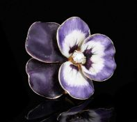 Edwardian gold diamond and enamel earring, naturalistically modelled as a pansy, with purple and whi
