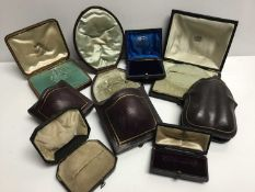 Eight antique leather jewellery boxes for earrings and brooches
