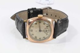 1940s gentleman's 9ct gold cased wristwatch on black leather strap