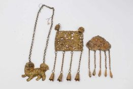 Old Chinese gilt metal panel necklace decorated with a figure riding a dragon, one other gilt metal