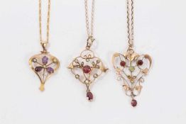 Three Edwardian 9ct gold seed pearl and gem set open work pendants on 9ct gold chains