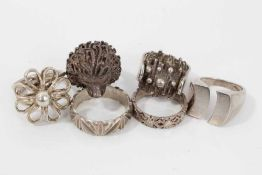 Six silver and white metal rings