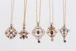 Five Edwardian 9ct gold gem set open work pendants on 9ct gold chains