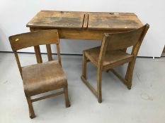Antique school desk and pair of child's desk chairs