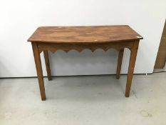 Old pine bow front side table with gothic arched frieze on square taper legs