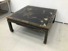 Chinese black lacquered and chinoiserie decorated coffee table together with a pair of matching lamp