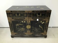 Chinese black lacquered cupboard with chinoiserie gilded decoration, two drawers and cupboards below