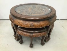 Chinese circular carved coffee table with integral nest of tables
