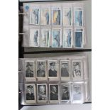 Cigarette cards - Two blue binders (10/11) containing a large selection of miscellaneous cards.