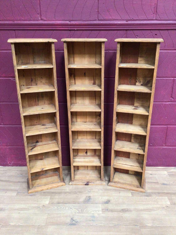 Three pine narrow high shelving units