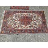 Three Eastern rugs, largest is 154cm x 92cm