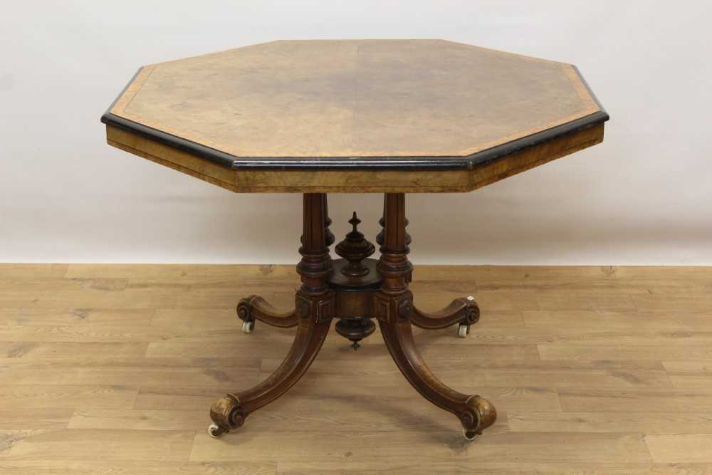 Victorian walnut octagonal centre table with burr wood crossbanding, on turned supports