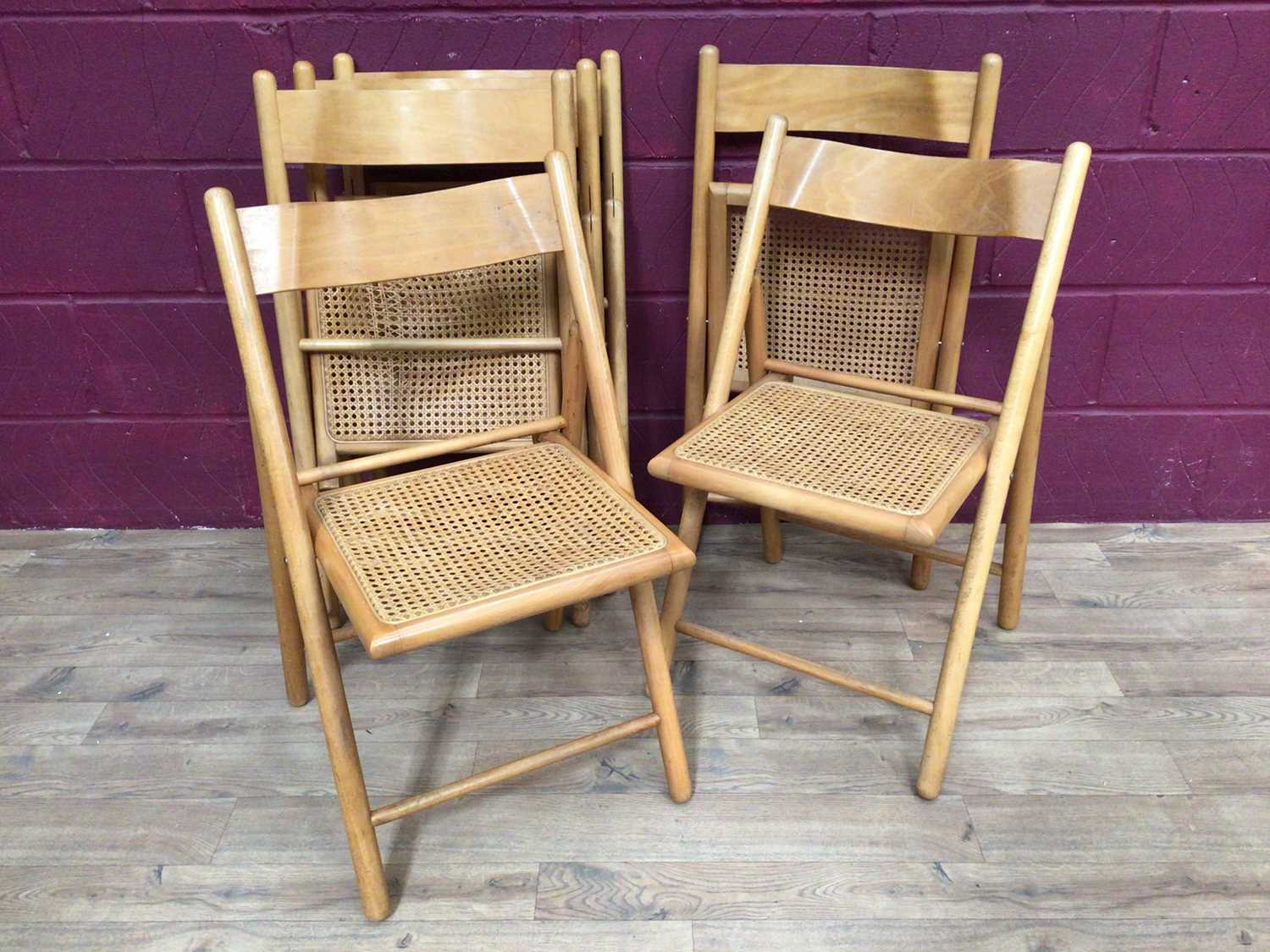 Six beech folding chairs with cane seats