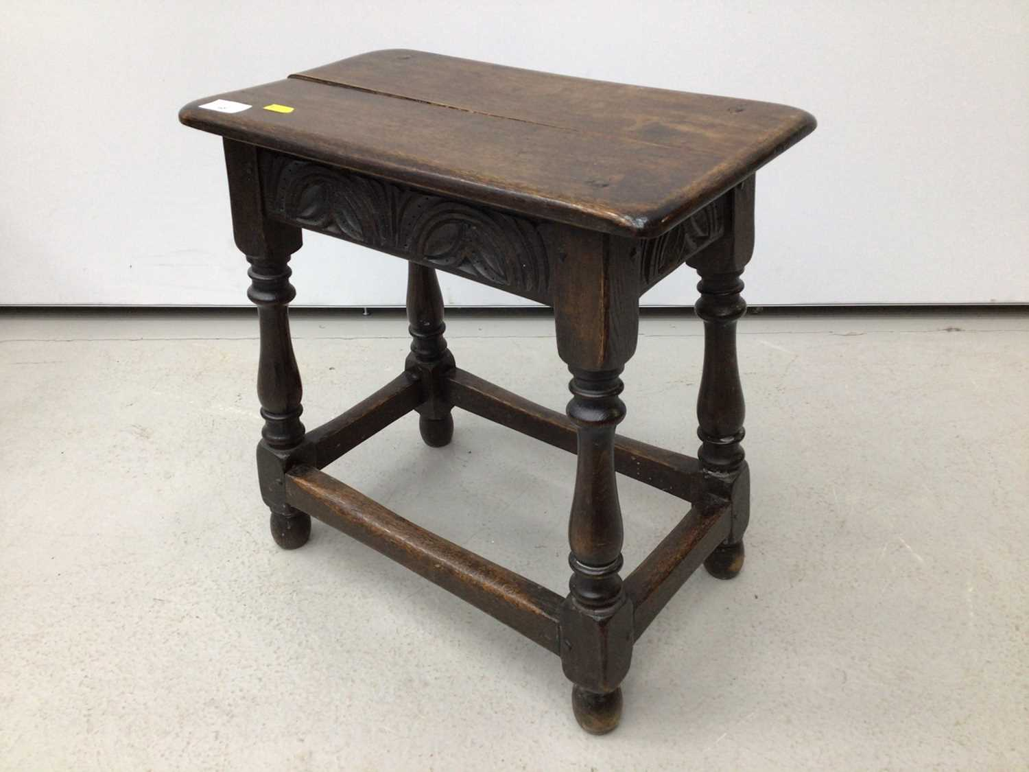 Carved oak joint stool on turned and block legs joined by stretchers, 44cm wide x 25cm deep x 45.5cm - Image 2 of 4
