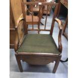 19 th century mahogany commode elbow chair
