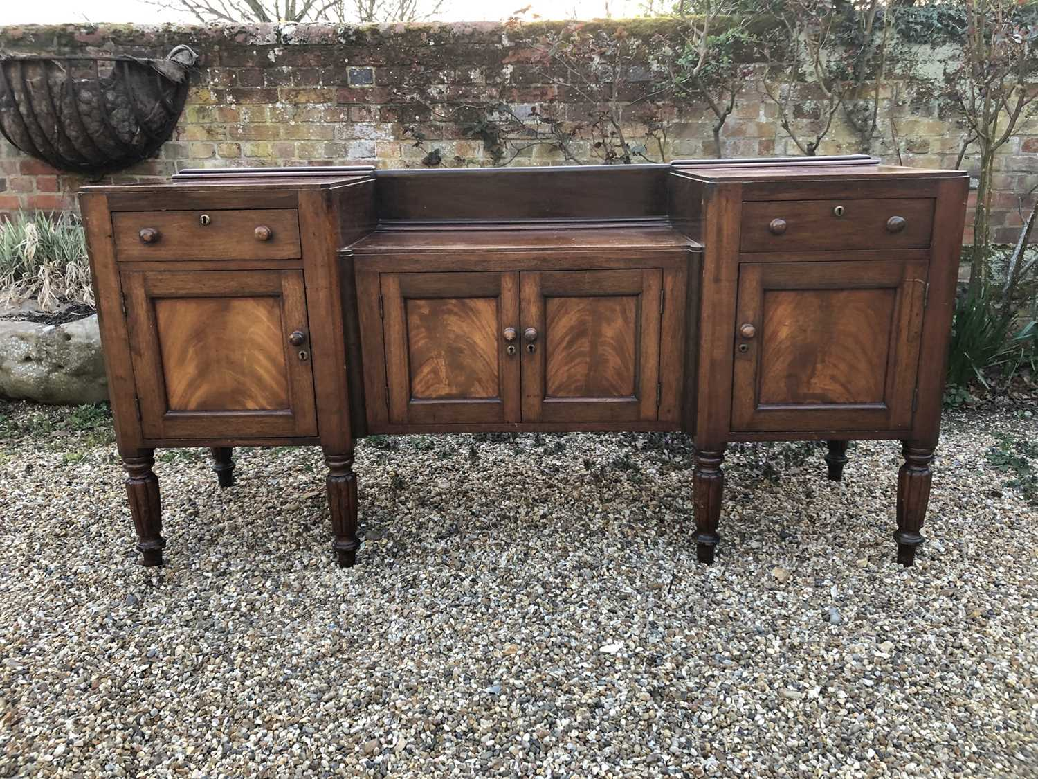 William IV mahogany sideboard with sunk centre and an arrangement of two drawers and four cupboards,