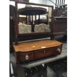 Regency mahogany swing frame mirror