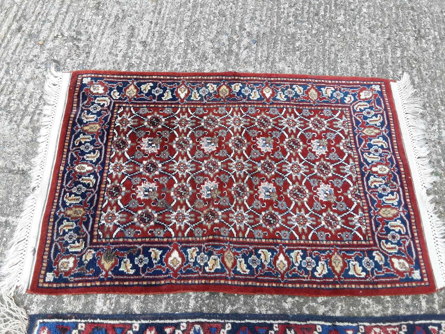 Two Eastern rugs with geometric decoration on red and blue ground, 113cm x 72cm and 97cm x 62cm - Image 2 of 3