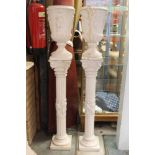 Pair of reconstituted alabaster classical urns on stands