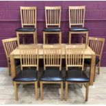 Good quality light oak dining room table and set of eight chairs