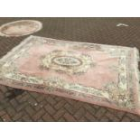 Chinese wash rug with floral decoration on peach ground 274cm x 186cm with a smaller round rug of si