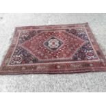 Eastern rug with geometric decoration on red and blue ground, 199cm x 148cm