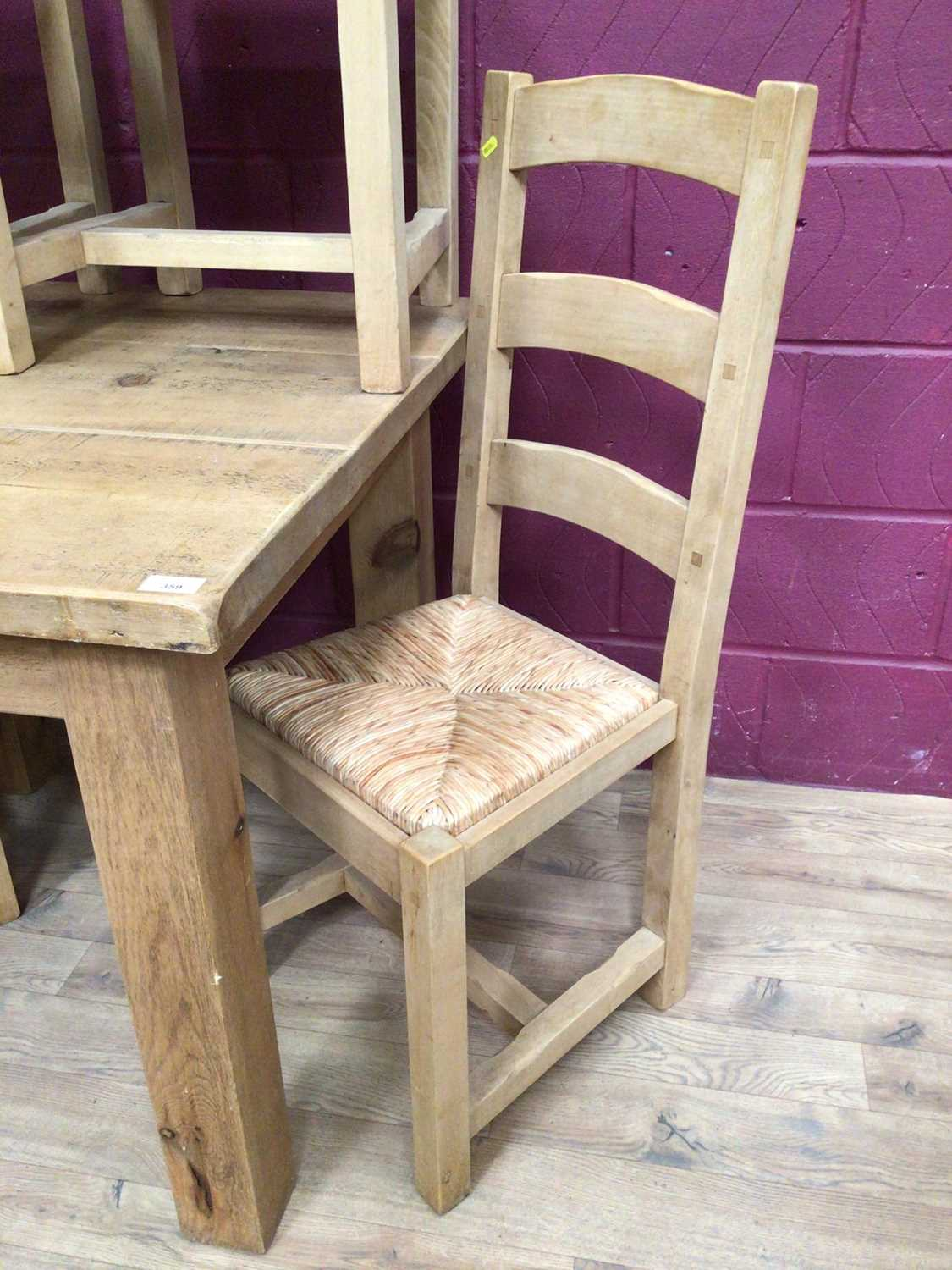 Contemporary light oak dining table and four matching ladder back chairs with rush seats - Image 4 of 5