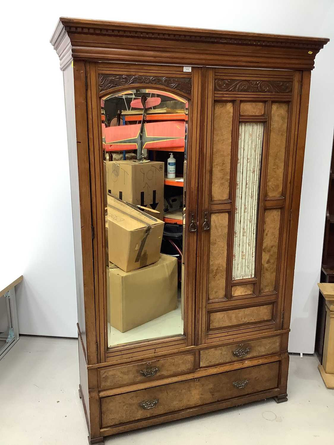 Late Victorian walnut double wardrobe enclosed by one bevelled mirror door and one glazed and panell