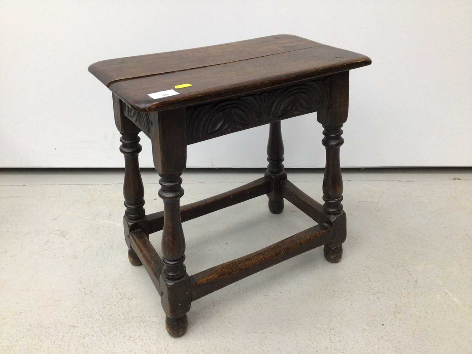 Carved oak joint stool on turned and block legs joined by stretchers, 44cm wide x 25cm deep x 45.5cm
